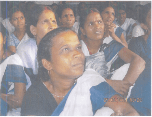 ashas attending a training session